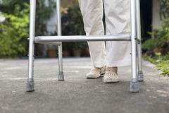 Senior woman using a walker. At home Stock Photography