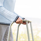 Senior woman using a walker Stock Images