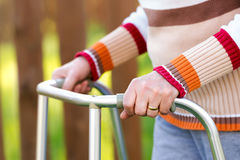 Senior woman using a walker Stock Photo