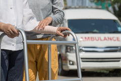 Senior woman using a walker  to take ambulance Royalty Free Stock Photography