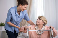 Senior woman using walking frame Stock Photos
