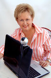 Senior woman using webcam Stock Photos