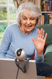 Senior Woman Using Webcam To Talk With Family Royalty Free Stock Photo