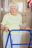 Senior Woman Using Zimmer Frame Stock Photography