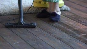 Senior woman vacuuming floor at home stock video
