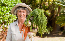 Senior woman with vegetables Stock Image