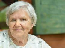 Senior woman on the veranda. Royalty Free Stock Photography