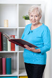 Senior woman viewing photo album Stock Image