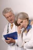 Senior woman visiting doctor Stock Image
