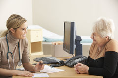 Senior woman visiting Doctor Stock Images