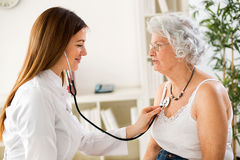 Senior woman visiting a doctor Stock Image