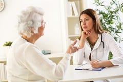 Senior woman visiting a doctor Stock Photo