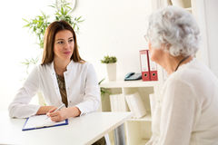 Senior woman visiting a doctor Stock Photography