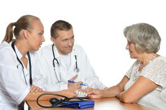 Senior woman visiting doctors Stock Photography
