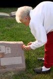 Senior Woman Visiting Grave Royalty Free Stock Photography