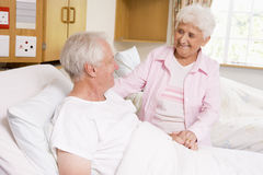 Senior Woman Visiting Her Husband In Hospital Stock Photography
