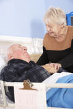 Senior woman visiting husband in hospital Royalty Free Stock Photography