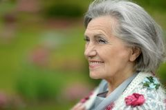 Senior woman on walk in summer park Royalty Free Stock Photography