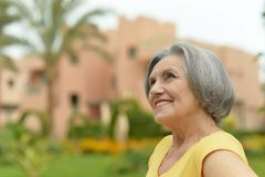 Senior woman on a walk in tropic resort Royalty Free Stock Photos