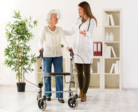 Senior woman with walker on consultation with the doctor Royalty Free Stock Photos