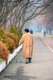 Senior woman walking with aid Stock Image