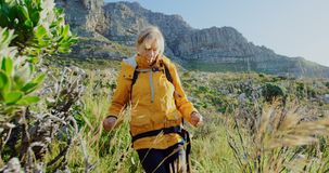 Senior woman walking in countryside 4k stock video footage