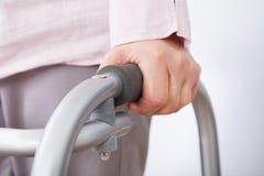 Senior woman with walking frame Stock Photo