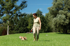 Senior woman walking her dog Royalty Free Stock Images