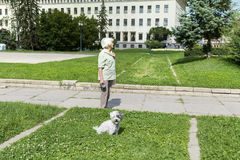 Senior woman walking  her dog in the city of Sofia Stock Images