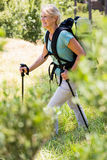 senior woman is walking with her stick Stock Photography