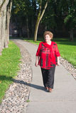 Senior woman walking outdoors Royalty Free Stock Photo