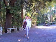 Senior woman walking  in the park stock images