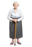 Senior woman with walking stick standing on white Stock Photo