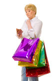 Senior woman with wallet and bags Royalty Free Stock Photo