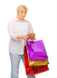 Senior woman with wallet and bags Royalty Free Stock Photos