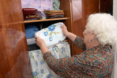 Senior woman and wardrobe Stock Photo