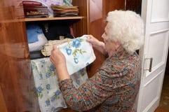 Senior woman and wardrobe Royalty Free Stock Photo