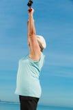 Senior woman warming up with walking poles Royalty Free Stock Photo