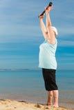Senior woman warming up with walking poles Royalty Free Stock Image
