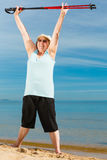 Senior woman warming up with walking poles Stock Photography