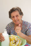 A senior woman is washing cloths by hand Royalty Free Stock Photography