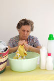 A senior woman is washing cloths by hand Stock Photography