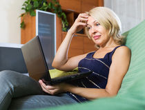 Senior woman watching soap show Stock Images