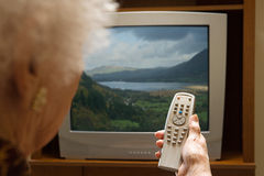 Senior woman watching television Stock Photography