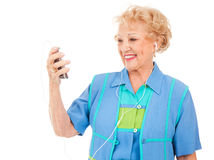 Senior Woman Watching Video Stock Photo