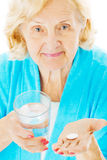 Senior Woman With Water Glass And Tablet Stock Photo