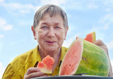 Senior woman with watermelon Stock Photo