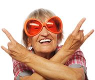 Senior woman wearing big sunglasses Royalty Free Stock Photos