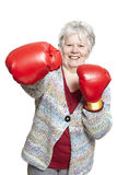 Senior woman wearing boxing gloves smiling Royalty Free Stock Photography