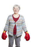 Senior woman wearing boxing gloves smiling Stock Photography